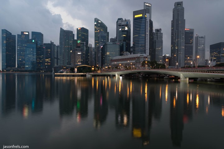 Singapore skyline reflected at dawn