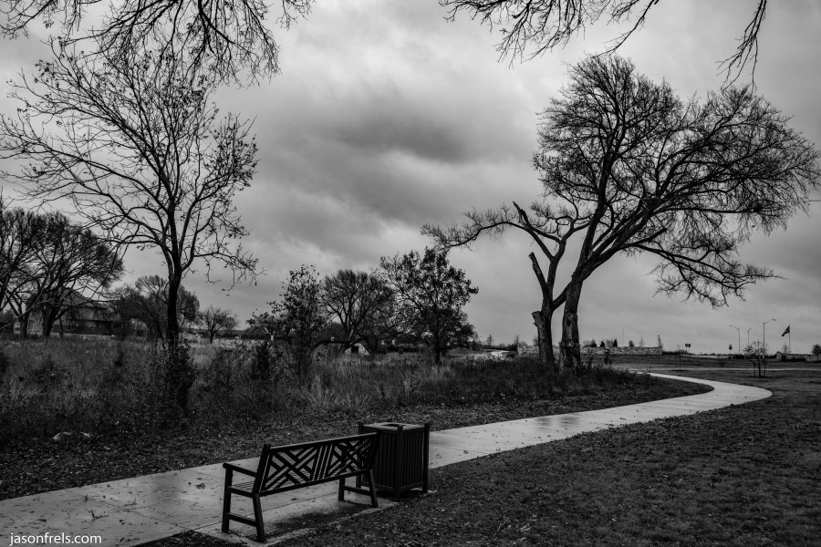Leander park bench on a cloudy day in black and white