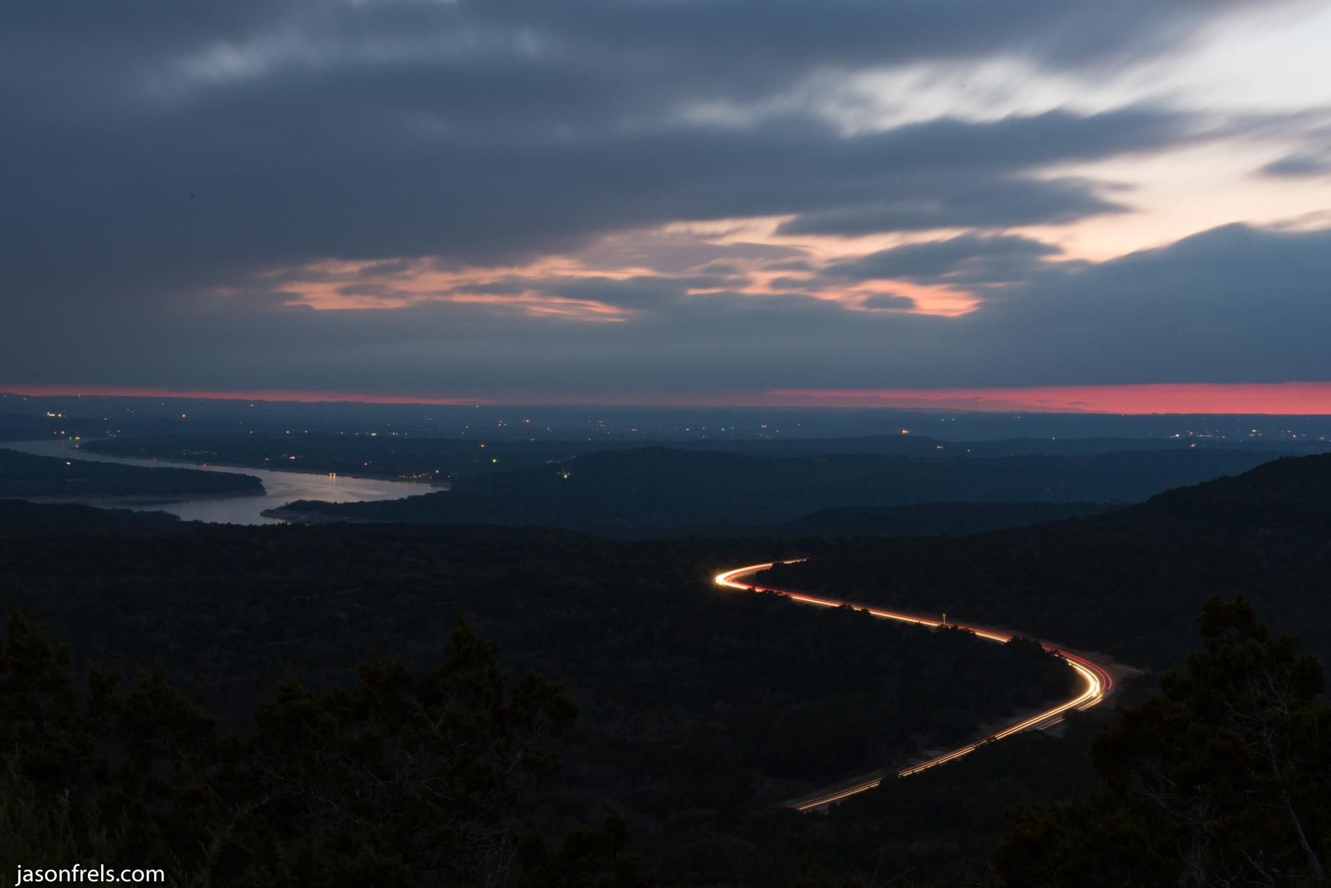 Long exposure clouds and highway lake travis
