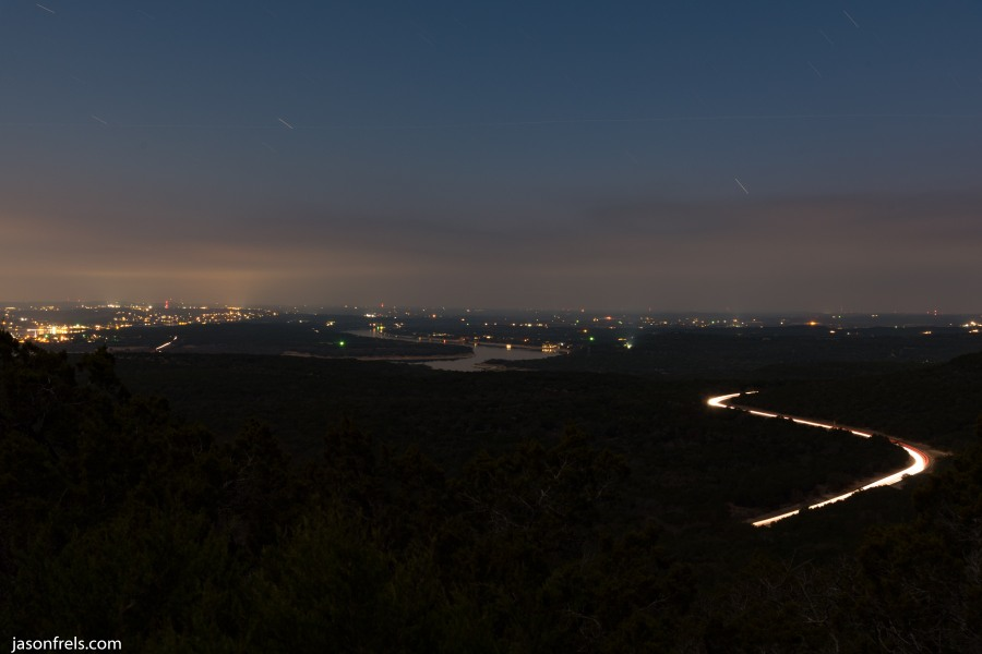 Long exposure of clouds and highway showing lake Travis
