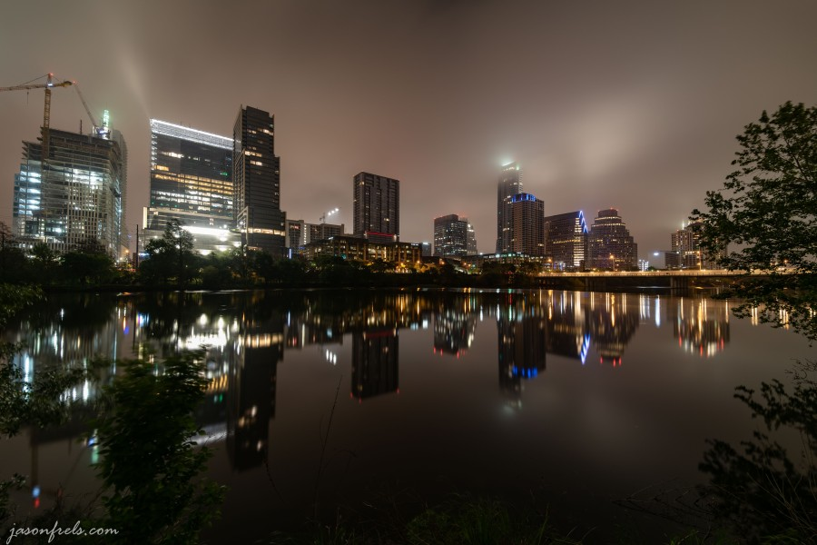 Downtown Austin Texas at cloudy predawn twilight reflected in Lady Bird Lake