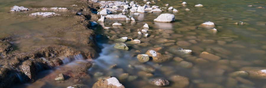 Long exposure of water rushing over rocks in the Colorado river Texas