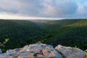 Sun rise at Lost Maples State Natural Area from high cliff