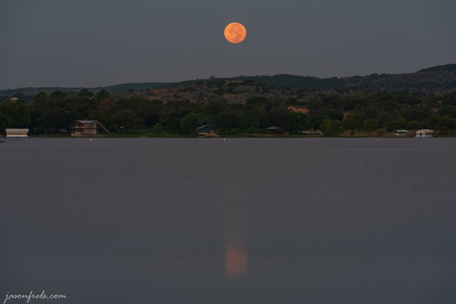 Full moon setting over Inks Lake Texas just before dawn