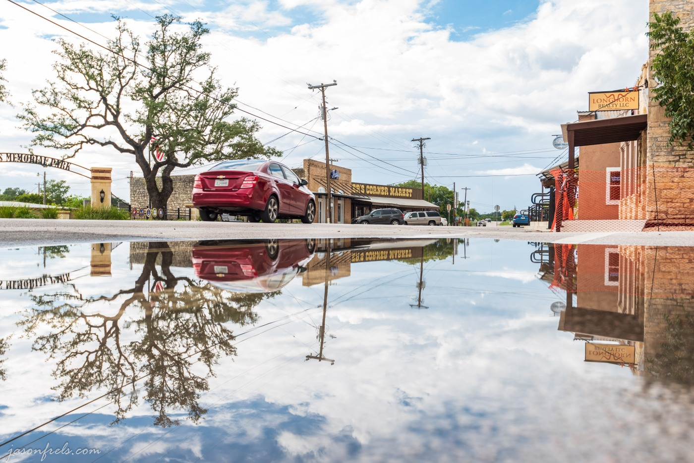 Reflections in a rain puddle in Liberty Hill Texas
