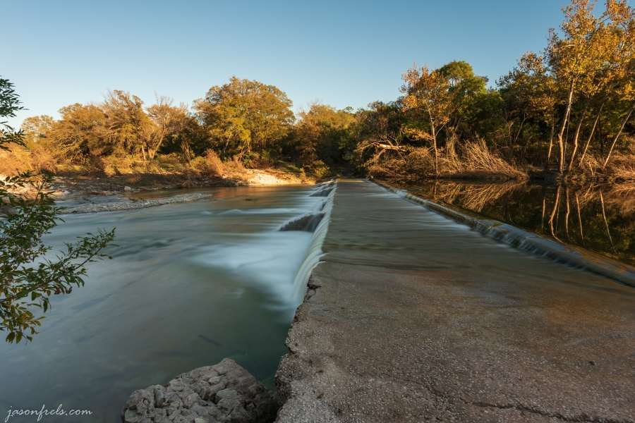 Waterfall at a dam near Liberty Hill Texas with fall colors