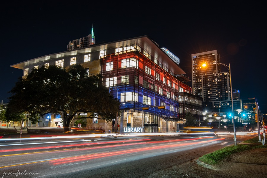 Austin Central Libary at night in color with blurred car lights