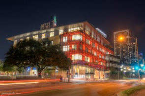 Austin Central Library in Austin Texas at night in orange