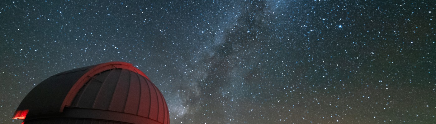 Milky Way over telescopes at the McDonald Observatory in Texas
