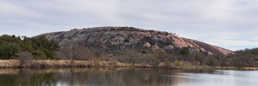 Enchanted Rock reflected in Moss Lake