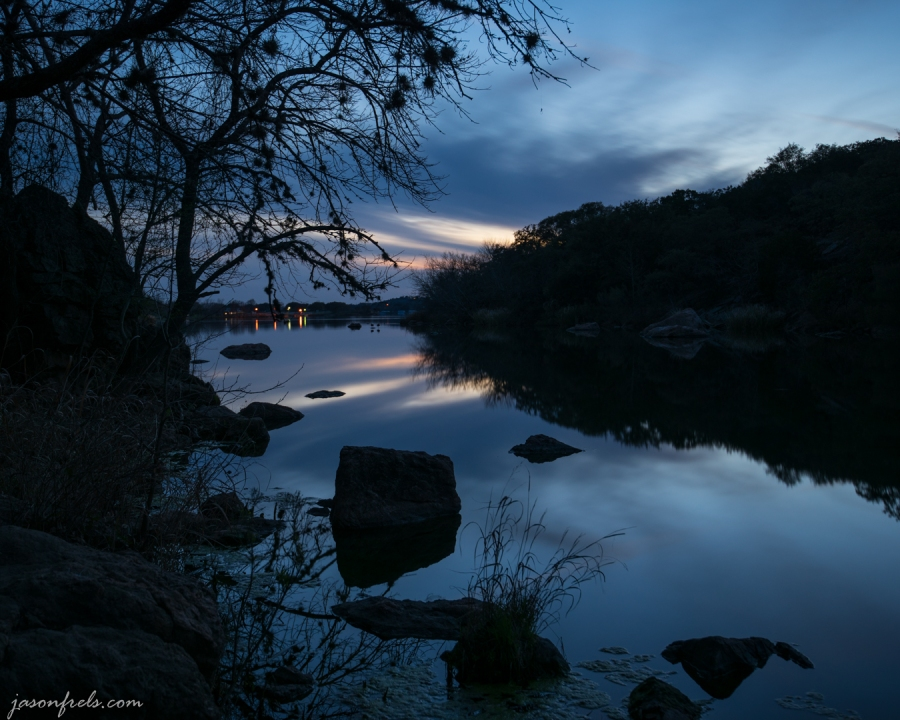 Blue hour sky reflected in the lake at Inks Lake State Park in Texas