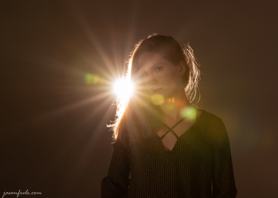 Flash behind model creating star pattern in the light